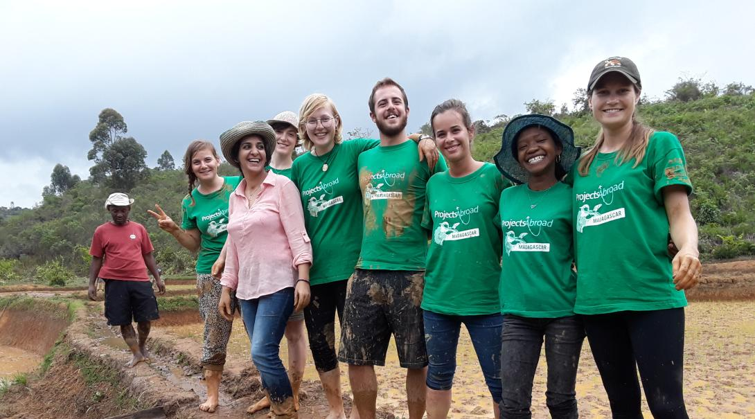 Volunteers take a group photo after their work day abroad in Madagascar